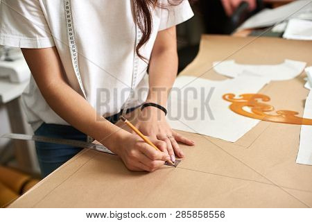 Workplace In Design Studio, Pattern Creation Process. Female Designer Hands Close-up Making Drawing