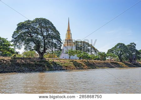 View From The River To The Buddhist White And Gold Temple In Ayuthaya - A Unesco World Heritage Site