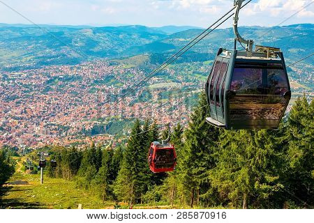 View From The Top Of The Mountain On The City Of Sarajevo And Funiculars Rising Up To The Highest Po