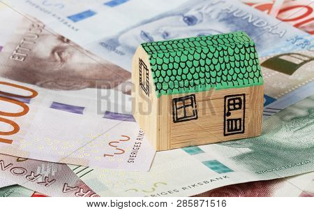 Stockholm, Sweden - February 10, 2017: One Miniature Wooden Single-family House On Swedish Banknotes