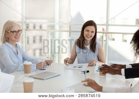 Meeting Of Businesspeople In Modern Light Boardroom