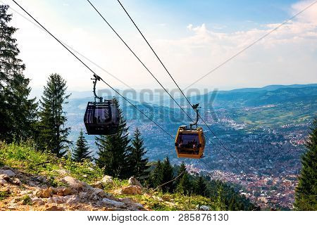 View from the top of the mountain on the city of Sarajevo and funiculars rising up to the highest point of the city. Sarajevo, Bosnia and Herzegovina poster