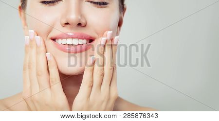 Perfect Woman Smile And Manicured Hand. French Manicure And Pink Lipgloss Makeup