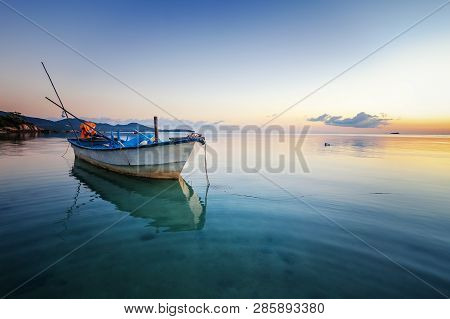 Blue Sea At Sunset, Boat Fishing  Shore Landscape Bay. Summer Beautiful   Scenery. Blue Water.