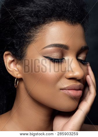 Portrait Of Young Beautiful Black Woman Touching Her Face. Cleaning Skin, Spa Therapy, Skincare, Cos
