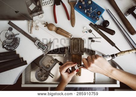 Creative Chaos. Top View Of Jewelers Workbench With Different Tools For Making Jewelry. Female Jewel