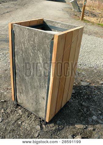 Rubbish bin with slate sides