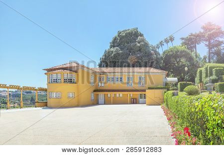 Porto, Portugal - June 16, 2018:  Yellow Office Building In The  Cristal Palace Gardens Or Jardins D