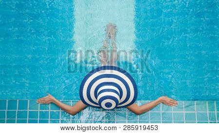 Beautiful young woman in spa in jacuzzi, Women are relaxing at the poolside, Woman relaxing in swimming pool spa, Relax pool spa poster