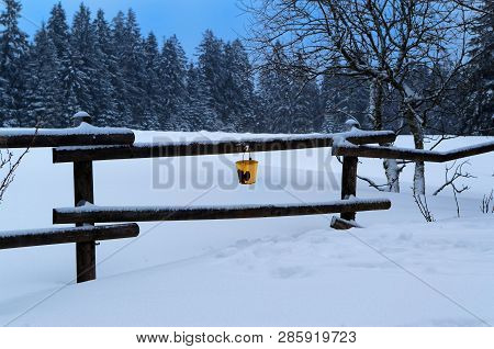 Winter Panorama With Yellow Bucket Hanging On The Railing. Sonnenberg, Germany