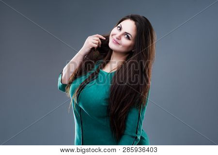 Happy Plus Size Fashion Model In Green Dress, Sexy Fat Woman On Gray Background