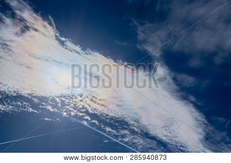 A Blue, Slightly Cloudy Sky. Blue Sky, Slightly Cloudy. The Sky Is Covered By A Thin Layer Of White