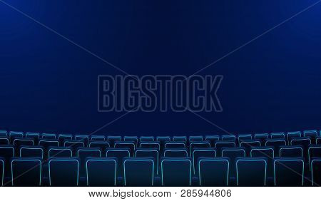 Realistic Rows Of Blue Chairs Cinema Or Movie Theater Seats In The Darkness. Cinema Auditorium And M