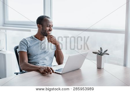 Successful Man Working At Computer In Modern Office