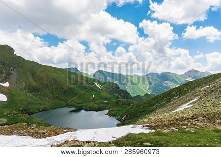 Summer Time In Romanian Carpathians. Beautiful Landscape Of Fagaras Mountains. Lake Capra Down In Th