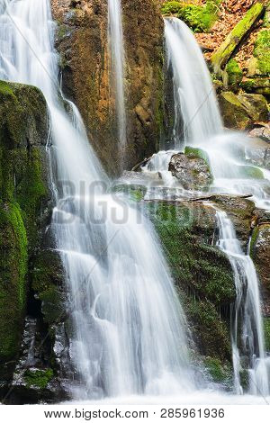Waterfall With Small Cascades. Beautiful Nature Background In Summer. Long Exposure
