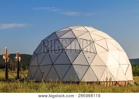 White Geodesic Dome On Sunny Summer Day