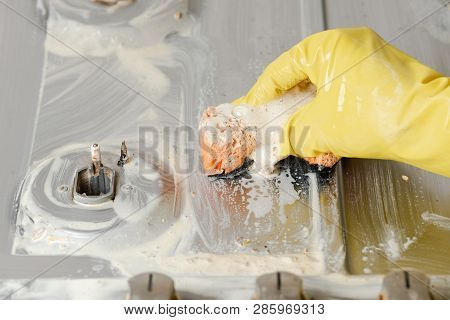 Hand In Yellow Glove Squeezing Orange Sponge. Hand In Yellow Gloves Clean Dirty Kitchen Cooker Indoo