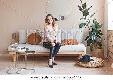Girl In Leather Pants And High Heels In Room Interior