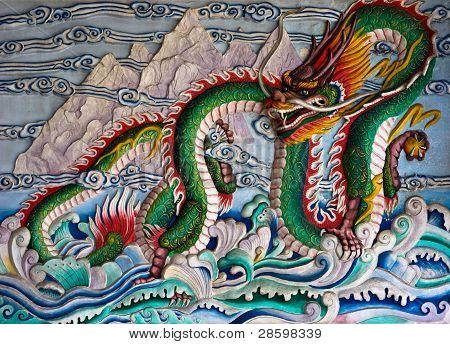 Dragon statue on wall