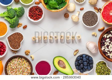 Frame Of Superfood Clean Eating Selection: Fruit, Vegetable, Seeds, Superfood, Nuts, Berries On Whit
