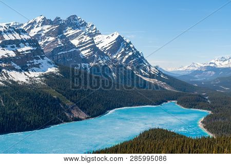Spring Aerial View Of The Peyto Lake And Snowy Rocky Mountains In Background - Banff National Park,
