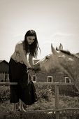 portraite of attractive girl and horse. outdoor shot poster
