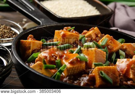 Mapo Tofu Dish With Pork Chives Soy Sauce Garlic And Spices Closeup In Cast Iron Skillet