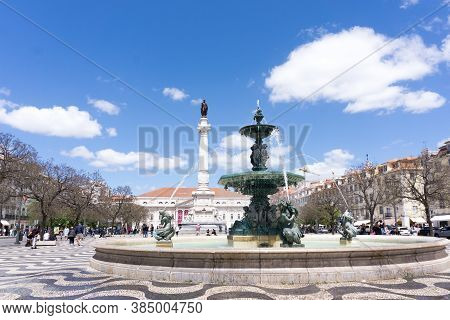Lisbon, Portugal - May 13, 2018: The Praça Dom Pedro Iv Square Or Rossio Square In The City Centre O