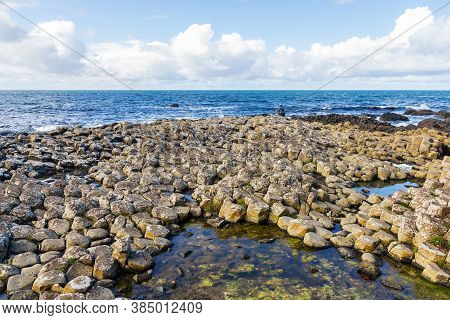 Coast Of Giants Causeway In Northern Ireland With Volcanic Basaltic Stones