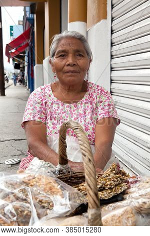 Oaxaca, Mexico - May 8, 2015: Elderly Woman Selling Traditional Mexican Sweets On The Street In Oaxa