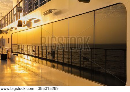 Sunset Reflection On Deck Of An Ocean Cruise Ship