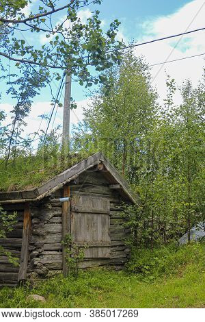 Old Wooden Cabin Hut With Overgrown Roof, Hemsedal, Norway.