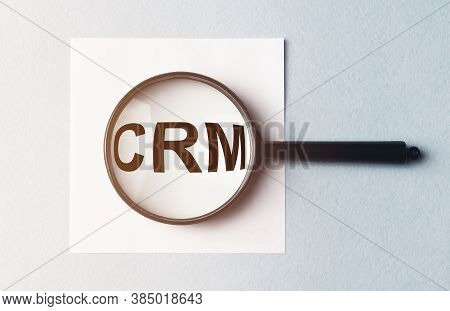 A Concept Image Of A Man Hand Holding Magnifying Glass With A Word Crm Zoom Inside The Glass, Crm Ac