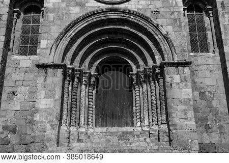 Coimbra, Portugal - Summer 2019: Medieval Church Of Santiago In Coimbra, Centro Region, Portugal. Bl