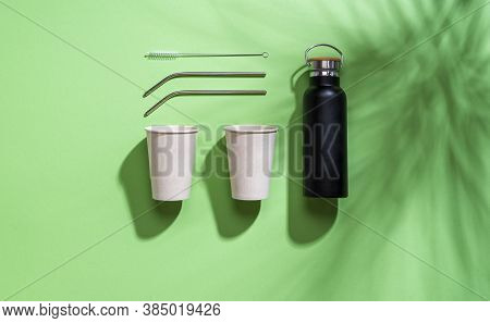 Above View With Nonplastic Cups, Metal Straws, And Thermos. Sustainable Drinking Containers Isolated