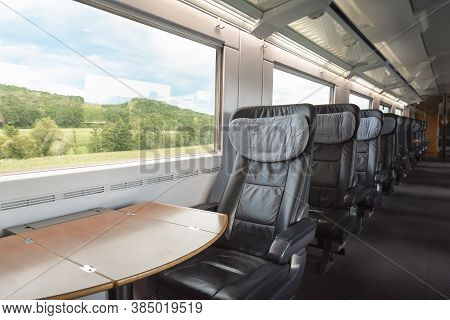 Intercity-express Train Interior With Empty Seats, At Business Class, In Motion. Inside Of High-spee