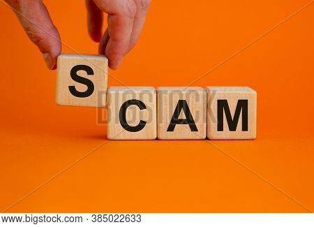 Concept Word 'scam' On Cubes On A Beautiful Orange Background. Male Hand. Business Concept. Copy Spa