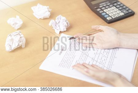 Drawing Up And Signing Insurance Contract. Close-up Female Hands Hold Pen To Fill Out Document And C