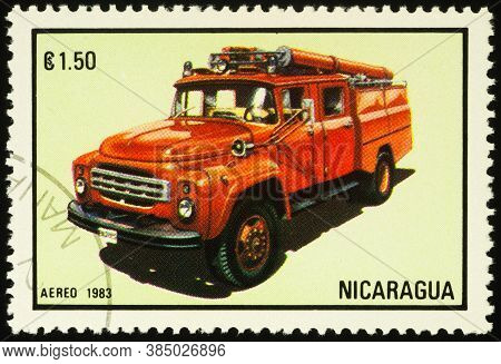 Moscow, Russia - September 12, 2020: Stamp Printed In Nicaragua Shows Red Firetruck, Series Fire Eng