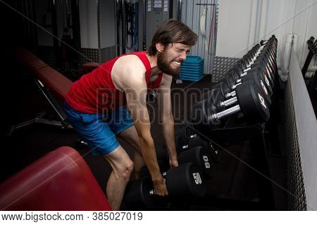 Weak Man Tries To Lift Heavy Dumbbell, Wants To Be Strong And Fit. Sport, Motivation, Strength. Newb