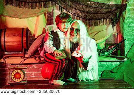 Family Halloween Party. A Terrible Night On Halloween. Father And Son Has Fun In Halloween Time. Por