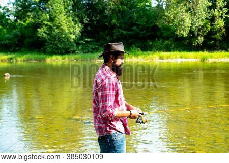 Fishman Crocheted Spin Into The River Waiting Big Fish. Man Bearded Fisherman. Hunting. Fisher Fishi
