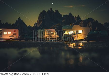 Summer Vacation And Road Trip In Motorhome. Recreational Vehicles Rvs Overnight Alpine Camping. Dolo