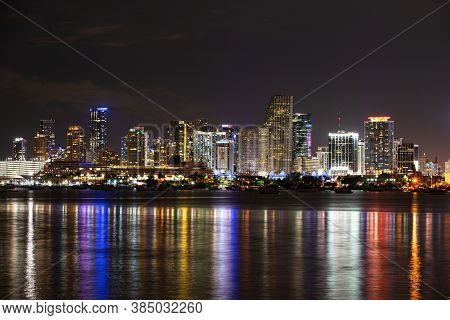 Miami, Florida, Usa Skyline On Biscayne Bay, City Night Backgrounds. Miami Skyline Panorama With Urb