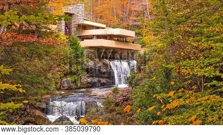 MILL RUN, PENNSYLVANIA, USA - OCTOBER 24, 2017: Fallingwater over Bear Run waterfall in the Laurel Highlands of the Allegheny Mountains.