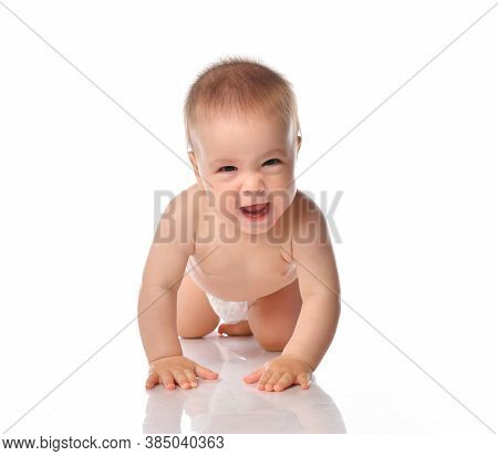 Cute Little Baby With Sly Evil Smile Wearing Diaper Crawling Forward To Camera. Funny Toddler With M