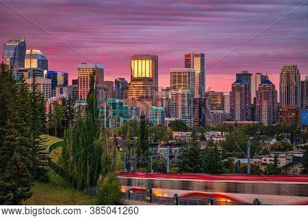A Moody Cloudy Sky Over The Downtown Calgary Skyline