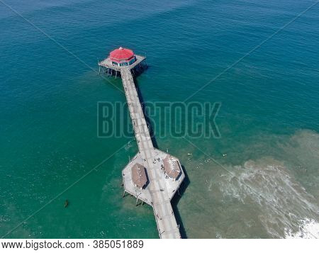 Aerial View Of Huntington Pier, Beach And Coastline During Sunny Summer Day, Southeast Of Los Angele