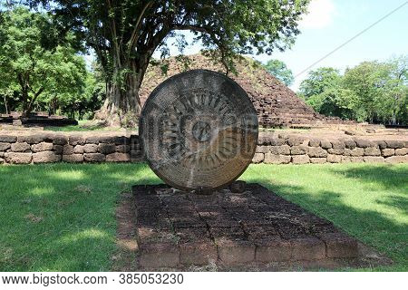 Stone Carving Of The Wheel Of The Dharma. In Archaeological Site Of Srithep Ancient Town In Petchabo